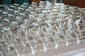 Rows of empty wine glasses on the table ready for guests Stock Photo