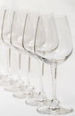 Rows of empty wine glasses. Royalty Free Stock Photo