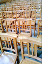 Rows of empty wooden chairs in church Stock Images