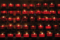 Rows of firing candles Stock Image