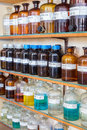 Rows of fluid chemicals in bottles at chemistry education