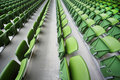 Rows of folded seats in empty stadium Royalty Free Stock Photos
