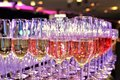 Rows of full champagne, sparkling wine and red wine glasses. Dining, drink. Royalty Free Stock Photo