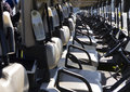 Rows of golf carts sunshine showing detail on a course on a bright morning steering wheels and seats Royalty Free Stock Photography