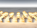 Rows of light bulbs with warm light and different sizes are growing in white pots that lie on a white and gray abstract Royalty Free Stock Images