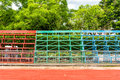 Rows of metal grandstand empty seats of football field Royalty Free Stock Image