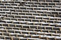 Rows of old concrete seats at abandoned stadium Royalty Free Stock Photo