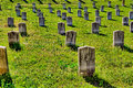 Rows of old, marble, unmarked grave headstones Royalty Free Stock Photo