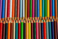 Rows of pencil crayons colorful wooden Royalty Free Stock Photography