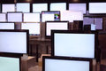 Rows of plasma TVs stand on shelves Royalty Free Stock Photo