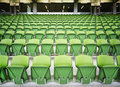 Rows of plastic seats in stadium Stock Photo