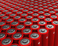 Rows of red batteries endless Stock Photography