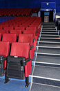 Rows of red and blue seats, entrance and stairs in auditorium