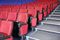 Rows of red and blue seats and stairs in auditorium cinema theater Royalty Free Stock Images