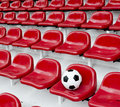 Rows of red football stadium seats with numbers Royalty Free Stock Photo