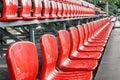 Rows of red mini-football stadium seats Royalty Free Stock Photo