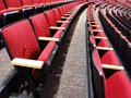 Rows of red theater seats detail in large auditorium Royalty Free Stock Photography