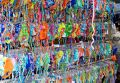 Rows and rows of colourful bikinis for sale in a market Stock Images