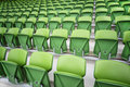 Rows of seats in empty stadium Stock Photo