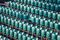 Rows of stadium seats and one special centeral seat Royalty Free Stock Photography
