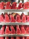 Rows of Steak on Metal Racks Stock Image