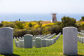 Rows of tombstones facing out to the Pacific ocean Royalty Free Stock Photo