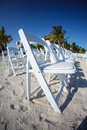 Rows of white chairs on beach Royalty Free Stock Photo