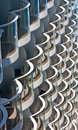 Rows of White and Chrome Balconies Stock Photo