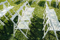Rows of white folding chairs on lawn Royalty Free Stock Photo