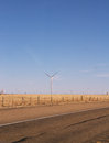 Rows of wind turbines in the countryside Stock Photo
