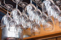 Rows of wine glasses on the showcase Royalty Free Stock Photo