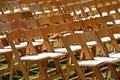 Rows of wooden chairs on lawn Stock Photos