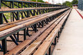 Rows of wooden grandstand empty seats of tennis field in natural light Stock Photography