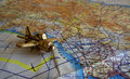 Photo : Royal Air Force flight map and brass aeroplane paperweight. wing cloudy