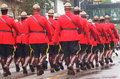 Royal Canadian Mounted Police Officers Marching In Parade Royalty Free Stock Photo
