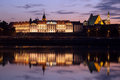 Royal castle and vistula river at twilight in warsaw illuminated with reflections on the waters the old town of poland Royalty Free Stock Image