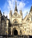 The royal courts of justice strand london commonly called law is a court building in which houses both high court and Stock Image