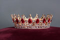 Royal crown with red gems. Ruby, garnet. Symbol of power and authority Royalty Free Stock Photo