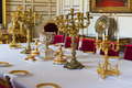 Royal dinner table details of the with golden candleholders and empty dishes Stock Photo