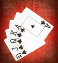 Royal flash of clubs on grunge poker table Royalty Free Stock Images
