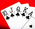 Royal flash on red poker table Royalty Free Stock Image