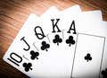 Royal flash on red poker table Royalty Free Stock Photography
