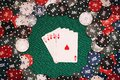 Royal flush on the background of gaming chips on the green table in the casino Royalty Free Stock Photo