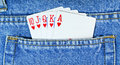 Royal flush in blue jean pocket. Poker Royalty Free Stock Photography