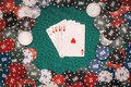 Royal flush in a game of poker on the background of a green table with gaming chips Royalty Free Stock Photo