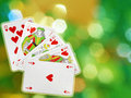 Royal flush placed on colorful background Stock Photography
