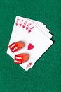 Royal Flush poker card sequence with dices Royalty Free Stock Images