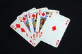 Royal flush poker hand in the diamond suit against a black background Royalty Free Stock Photos