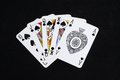 Royal flush poker hand in the spade suit against a black background Royalty Free Stock Photo