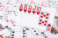 A royal flush poker shown sitting on spread out deck of cards Royalty Free Stock Images